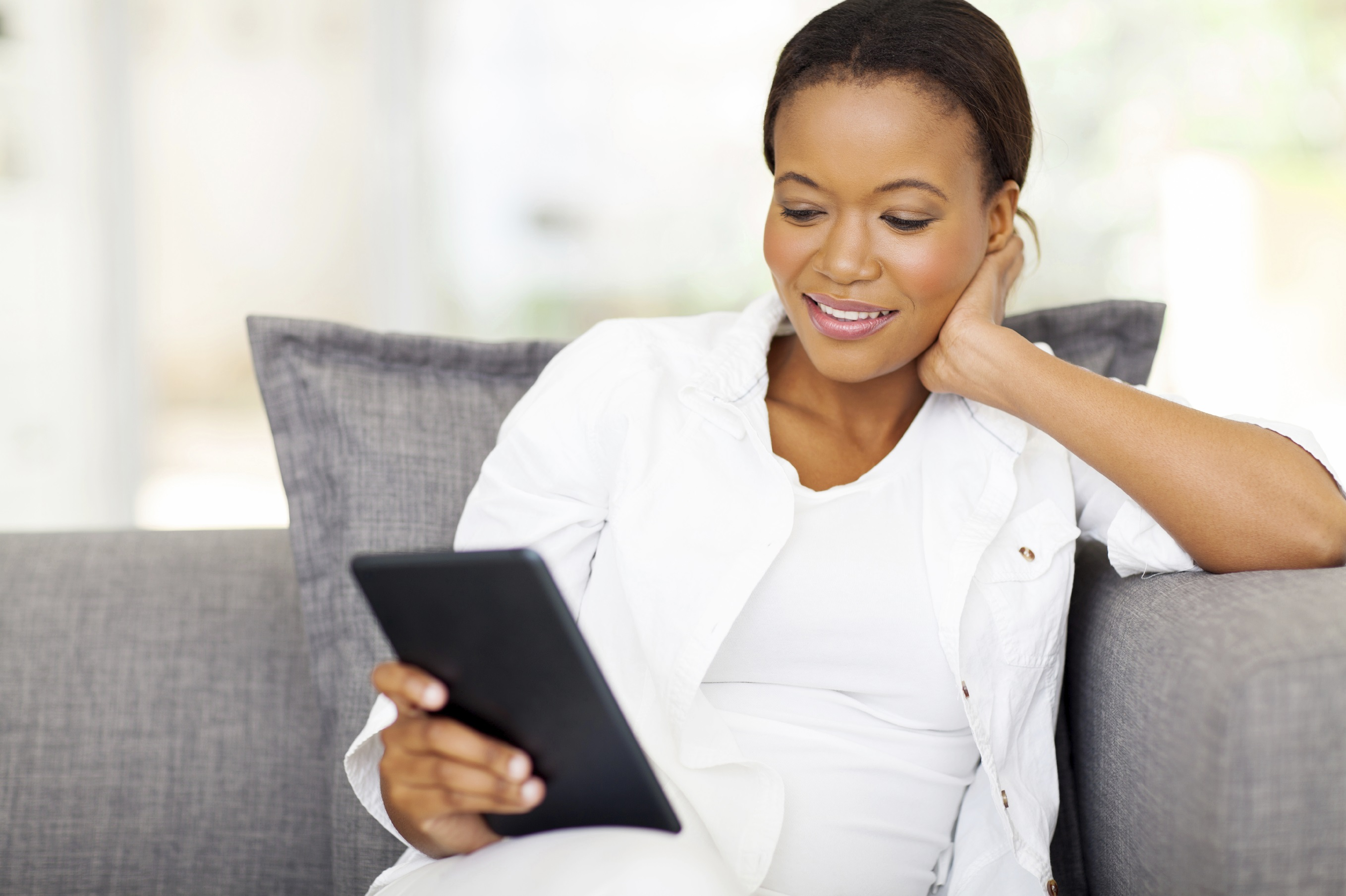 pretty african woman using tablet computer